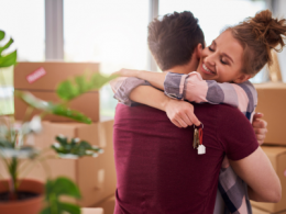 Couple Hugging and Moving Into New Home Together