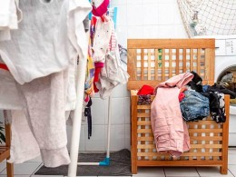 cluttered laundry room and hamper