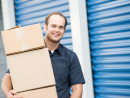 Man Moving Boxes Into Self Storage Unit