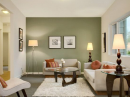 Living Room with green accent wall and furniture
